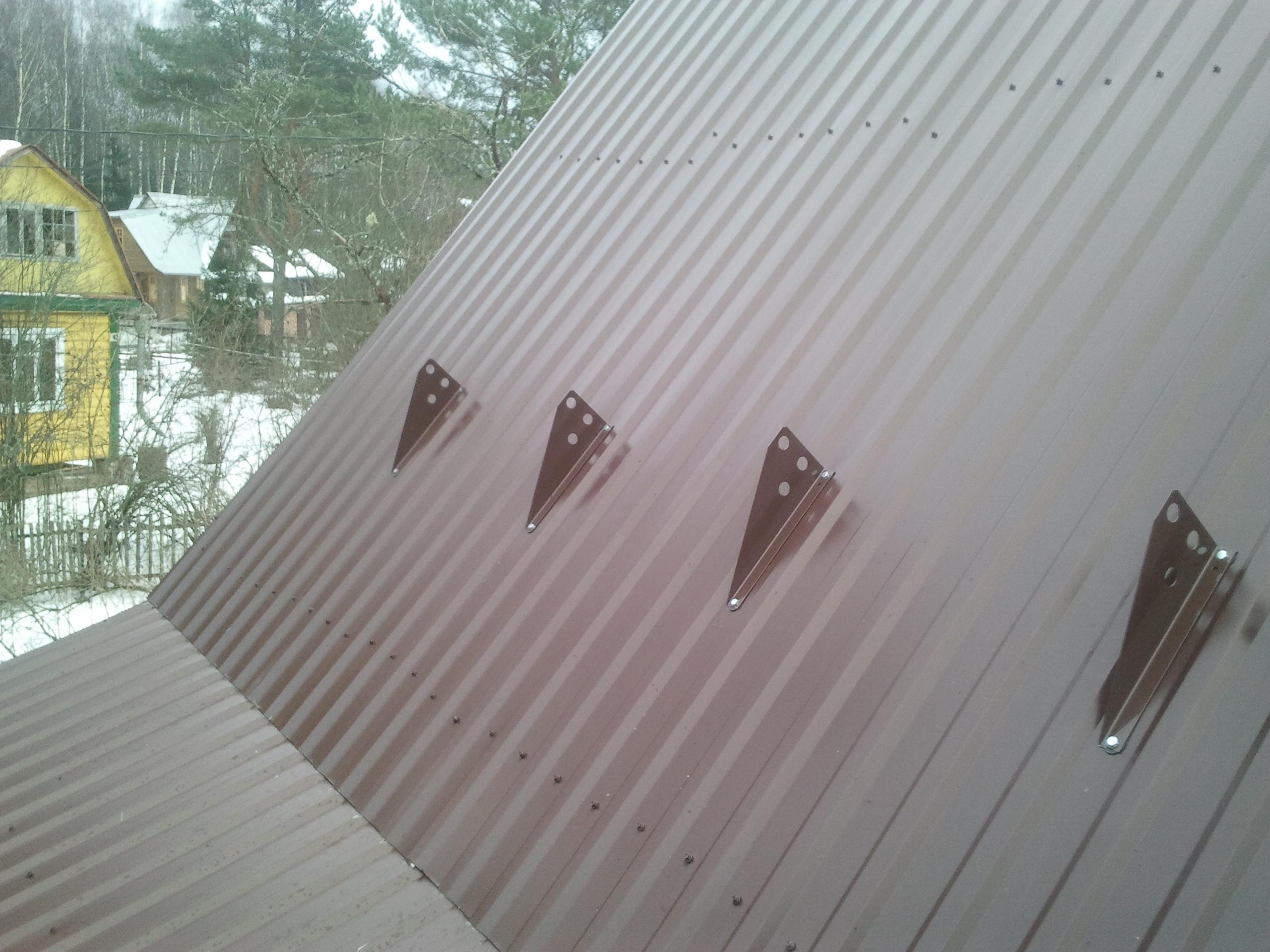 установка опор снегозадержателя